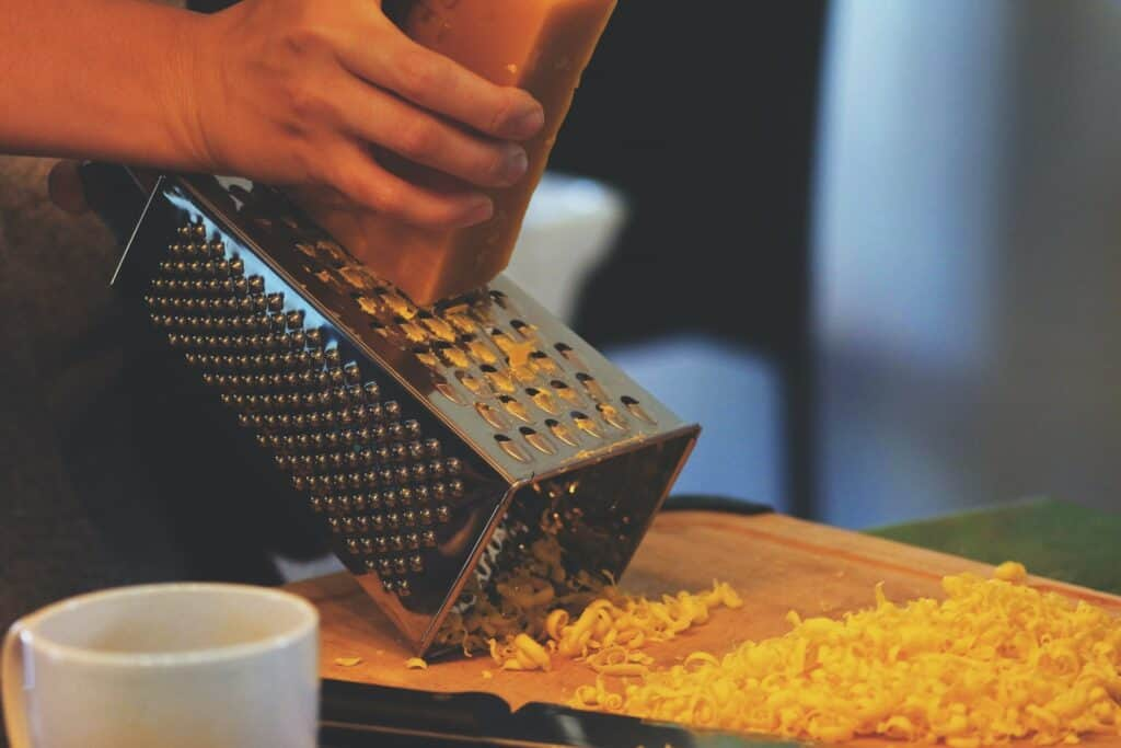 person grating cheese